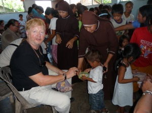 CHRF CEO, Colonel V. Doner, feeding children at Mother Joan's feeding project in the Philippines.