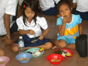Children in Cambodia with a hearty meal!