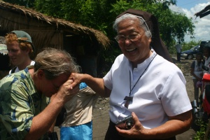 Ken McGrath, Gifts-In-Kind Coordinator for CHRF greets a happy Mother Joan in the Philippines.