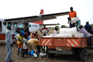 Young Sudanese Boys Help the CHRF team offload food and supplies from our plane.