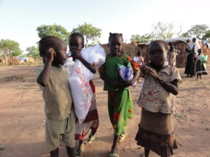 Children Return to their families with arms full after the CHRF Distribution!