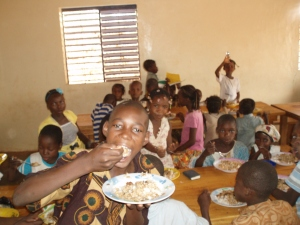 Some of the children with a very healthy and nutritious meal!