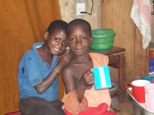 Two of the grandchildren often share Two of the grandchildren sharing one cup of porridge for a meal, the only meal they can afford or find for the entire day. cup of porridge for a meal, the only meal they can afford or find for the entire day.