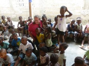 Team Director McGrath surrounded by grateful children at Christmas!