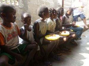 Only a few of the hundreds of children who wait for food this christmas.