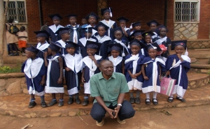 Reverend Emma with many of his precious graduates from the school and orphanage in Kampala.