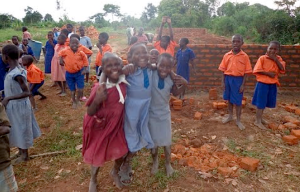 The children celebrating their new building!