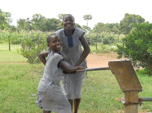 The children pumping water from their clean water well!