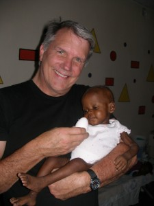 Dr. Wilson holds this beautiful baby girl who is now receiving life saving treatment.