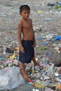 This boy's life consists of no school, no work, no playground, he will search through garbage everyday just to find enough plastic to sell for less then fifty cents if he is lucky.
