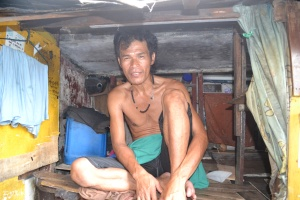 A father who lives underneath the bridge, cannot even sit up straight in his room that must also shelter his children.