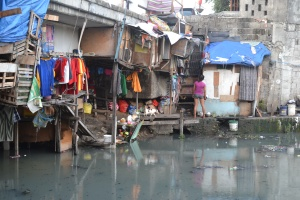 The filth and desperation of barely clinging to life that is beneath every bridge in Manilla