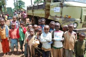 Hungry and now happy children awaiting the food distribution.