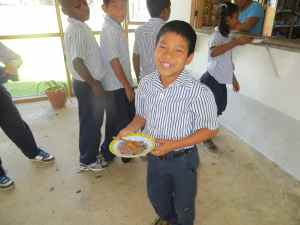 Juan at school getting his lunch provided with the help of CHRF!