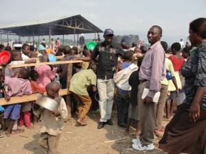 Pastor Vanensio reaching out to a local refugee camp.