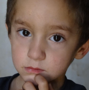 Families must flee the refugee camps where innocent children like this boy are not safe.