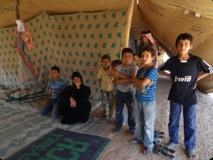 More than one million children are refugees. This family of nine lives under this shelter made out of blankets.