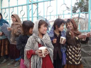 Children in Afghanistan smiling because of CHRF's food delivery!