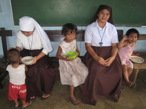 Some of our partners in the Philippines as they help to provide daily meals for the local children.