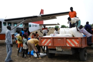 Unloading food and supplies for the children and families in the  Sudan.