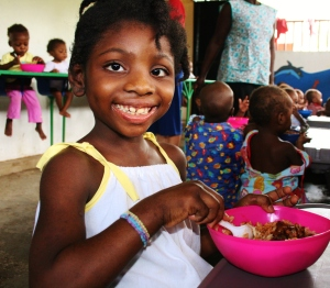 A beautiful child receives medical attention and food in Haiti!