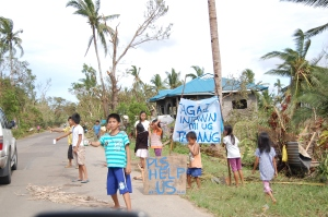 Children are accustomed to begging for food after the storms pass through in the Philippines.