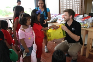 CHRF Project Coordinator Marcus Begley provides children with school supplies in Manila.