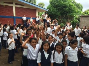 Many of the school children celebrating their hot lunch with our CHRF team!